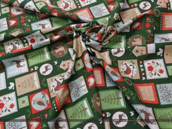 Karácsonyi bélyegek zöld dekorvászon tekert